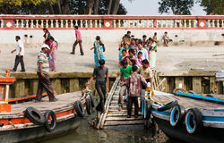 Many passengers board the boats on the quay of river Royalty Free Stock Photography