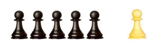 Many pawns black and other one yellow Stock Image