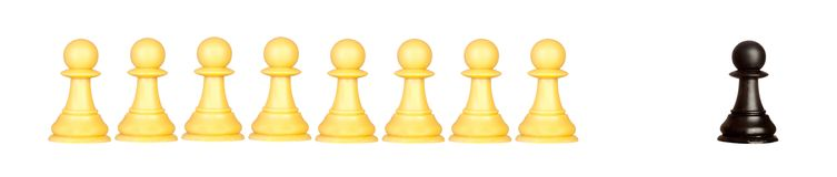 Many pawns black and other one yellow Royalty Free Stock Images