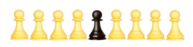 Many pawns yellow and other one black Stock Photos