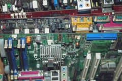 Many PC Computer motherboards. Circuit cpu chip mainboard core processor electronics devices. Old Motherboard digital chip. stock photo