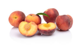 Many peaches with leaf  on white Royalty Free Stock Image
