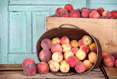 Many peaches in wooden crate and basket Stock Photography