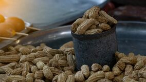 Many peanuts in a cup that are commercially