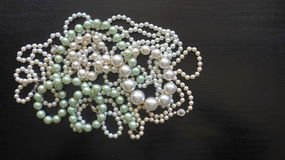 Many pearl necklaces and bracelets Stock Photo