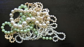 Many pearl necklaces and bracelets Stock Image