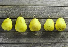 Many pears on a rustic wooden table. Useful fruit. Healthy diet food. Top view. Many pears on a rustic wooden table. Useful fruit. Healthy diet food Stock Image