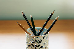 Many pencils in the box Royalty Free Stock Image