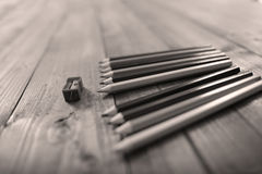 Many pencils and a sharpener Royalty Free Stock Images