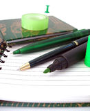Many pens on notebook Stock Photography