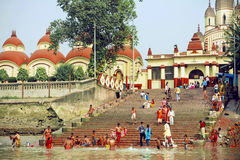 Many people bathing in water of river past historical Kali temple Royalty Free Stock Photography