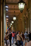 Many people in Bologna's passage way at night. BOLOGNA, ITALY - NOVEMBER, 2: many people in Bologna's passage way. In total, there are some 38 kilometres of Royalty Free Stock Photo