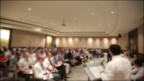 Many people came together at a conference or seminar. Blurred background stock video footage