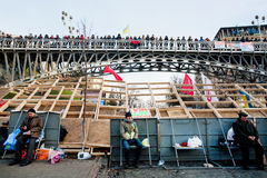 Many people on the city bridge and by barricades meet on anti-government demonstration during the week of pro-European protest Royalty Free Stock Image