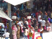 Many people in colorful clothes on the railway station in India stock footage