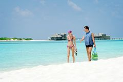 Couple in holiday at Paradise Island, Maldives. March 2012 Royalty Free Stock Photo