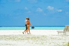 People in holiday at Paradise Island, Maldives. March 2012 Stock Images