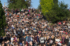 Many people in crowded park (Mauerpark) at  fete de la musique. Berlin, Germany - June 21, 2015: Many people in crowded park (Mauerpark) at fete de la musique Royalty Free Stock Photos