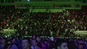 Many people dancing on tribune of huge nightclub. Spotlights. Zoom in out. Many people dancing on tribune of huge nightclub. Crowd. Spotlights. Night party. Zoom stock video footage