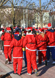 Many people dressed as Santa Claus during the race in the city Royalty Free Stock Image