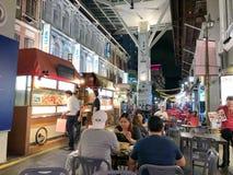 Many people enjoy eating china food at China town. CHINATOWN SINGAPORE - 29 NOV 2017: Many people enjoy eating china food at China town street food in Singapore Royalty Free Stock Photos
