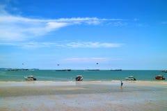 Many people enjoy outdoors activities on a sunny day at Pattaya beach, Pattaya city, Thailand. Summer holidays vacations stock images