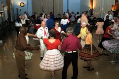 Several people enjoy square dancing stock photo