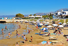 Many people enjoy a summer day at the Star Beach of Hersonissos on the island of Crete in Greece Stock Photography