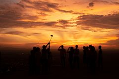 Many people enjoy take picture together their on sunset mountain. royalty free stock images