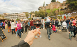 Many people with families walking the celebration streets with wine during festival Tbilisoba. Tbilisi, Georgia country Royalty Free Stock Photography