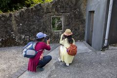 Many people focus on taking pictures, grab the cat funny picture. Taiwan`s famous tourist attractions, cat monk Ruifang Monkey Cave, tourists are taking pictures royalty free stock photography