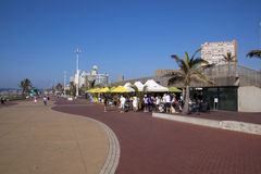 Many People Gathered at Beachfront Promenade Restaurant Royalty Free Stock Photos