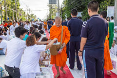 Many people give food and drink for alms to 1,536 Buddhist monks in visakha bucha day Stock Photography