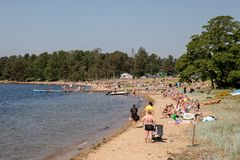 Kristiansand, Norway - June 3, 2018: Many people at the Hamresanden beach, on a very hot sunday in the summer. Royalty Free Stock Photography