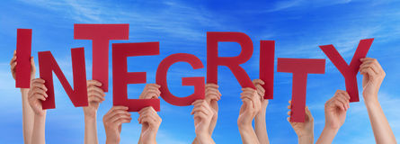 Many People Hands Hold Red Word Integrity Blue Sky. Many Caucasian People And Hands Holding Red Letters Or Characters Building The English Word Integrity On Blue Royalty Free Stock Image