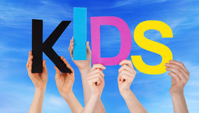 Many People Hands Holding Colorful Word Kids Blue Sky Royalty Free Stock Image