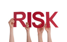 Many People Hands Holding Red Straight Word Risk. Many Caucasian People And Hands Holding Red Straight Letters Or Characters Building The Isolated English Word stock photography