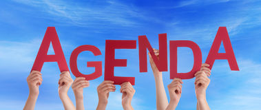 Many People Hands Holding Red Word Agenda Blue Sky stock images