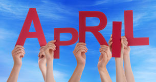 Many People Hands Holding Red Word April Blue Sky Stock Image