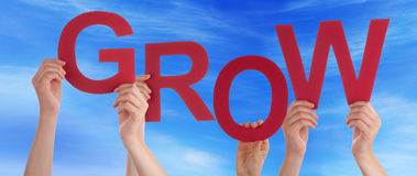 Many People Hands Holding Red Word Grow Blue Sky Stock Photo
