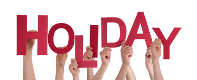 Many People Hands Holding Red Word Holiday Stock Image