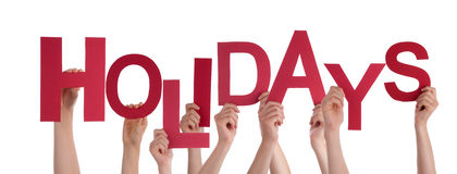 Many People Hands Holding Red Word Holidays Stock Photos