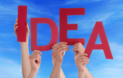 Many People Hands Holding Red Word Idea Blue Sky Stock Image