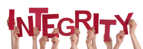 Many People Hands Holding Red Word Integrity. Many Caucasian People And Hands Holding Red Letters Or Characters Building The Isolated English Word Integrity On Royalty Free Stock Images