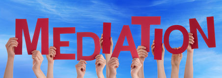 Many People Hands Holding Red Word Mediation Blue Sky. Many Caucasian People And Hands Holding Red Letters Or Characters Building The English Word Mediation On Stock Image