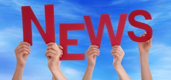 Many People Hands Holding Red Word News Blue Sky. Many Caucasian People And Hands Holding Red Letters Or Characters Building The English Word News On Blue Sky royalty free stock images