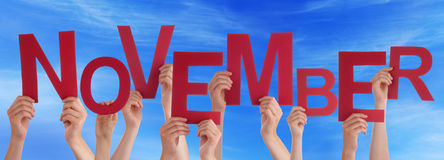 Many People Hands Holding Red Word November Blue Sky Royalty Free Stock Images