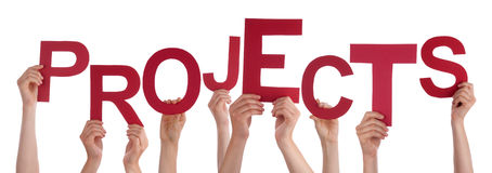Many People Hands Holding Red Word Projects. Many Caucasian People And Hands Holding Red Letters Or Characters Building The Isolated English Word Projects On stock photography