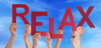 Many People Hands Holding Red Word Relax Blue Sky Stock Photos