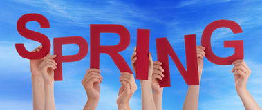 Many People Hands Holding Red Word Spring Blue Sky. Many Caucasian People And Hands Holding Red Letters Or Characters Building The English Word Spring On Blue royalty free stock photography